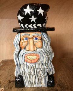 a lime wood carving of a wizard