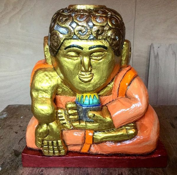 lime wood carving of a Buddha called Luke